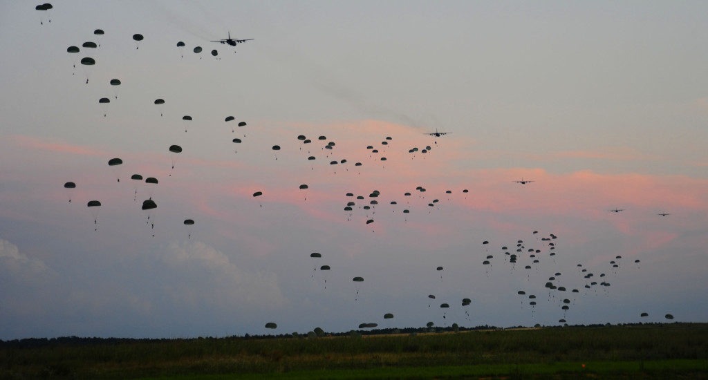 U.S. Soldiers with the 82nd Airborne Division parachute from a C-130 Hercules aircraft during Joint Operations Access Exercise (JOAX) 12-2 at Fort Bragg, N.C., June 5, 2012. A JOAX is a joint airdrop exercise designed to enhance service cohesiveness between U.S. Army and Air Force personnel, allowing both services an opportunity to properly execute large-scale heavy equipment and troop movement. (U.S. Air Force photo by Senior Airman Alexandra Hoachlander/Released)